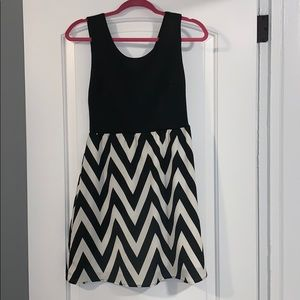 Dress with black and which zig zag bottom